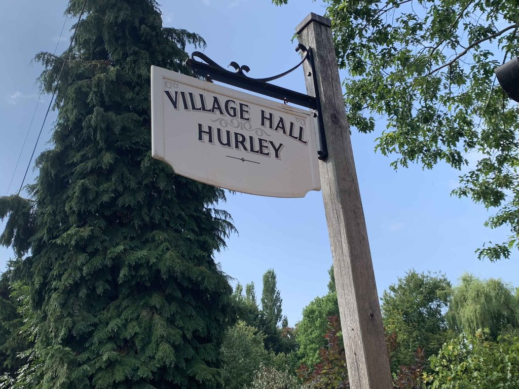 View of Hurley Village Hall sign in sunny skies