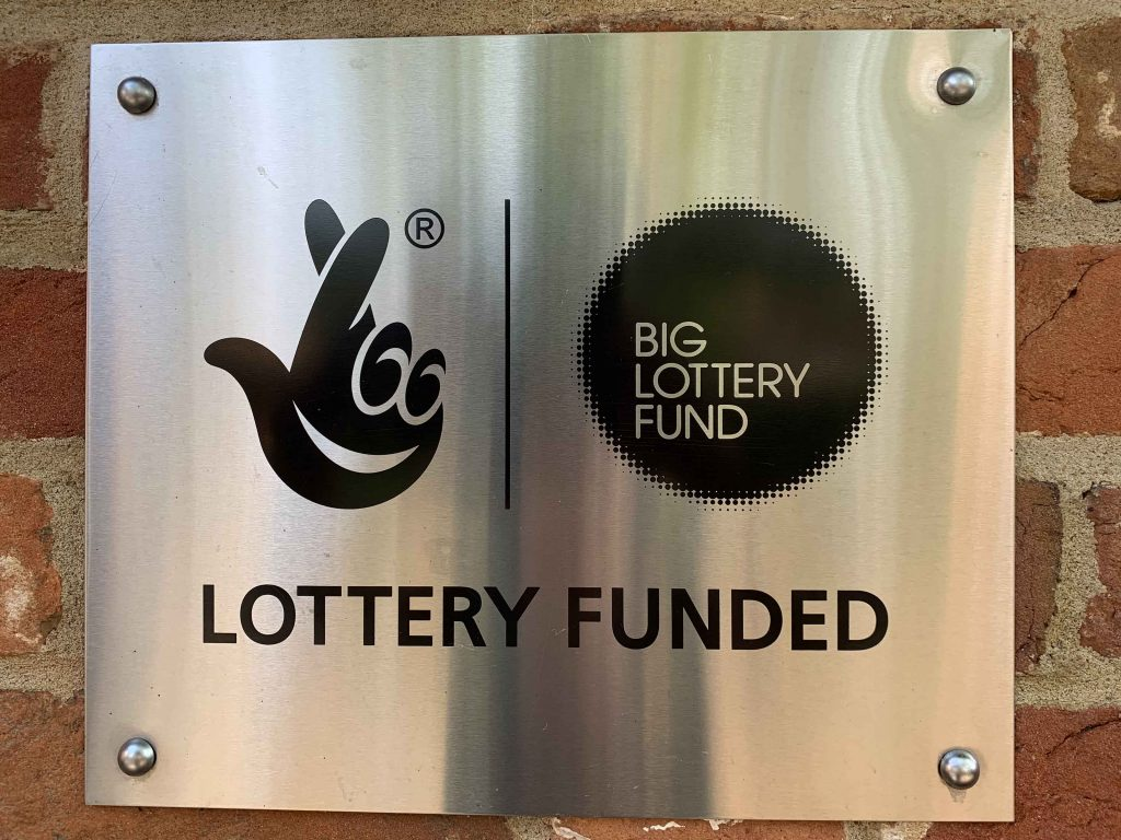 Silver plaque for Big Lottery Fund on brickwork